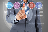 Composite image of businessman pointing at menu