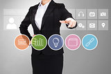 Businesswoman in suit pointing finger at business app buttons