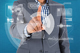 Composite image of focused businessman pointing to interface