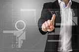 Composite image of businessman standing and pointing at interface