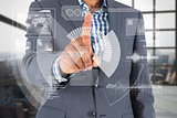 Composite image of focused businessman pointing at interface