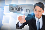 Businessman pointing to word solution