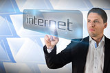 Businessman pointing to word internet