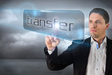Businessman pointing to word transfer