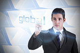 Businessman pointing to word global