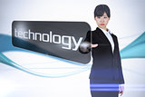 Businesswoman pointing to word technology