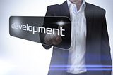 Businessman pointing to word development