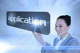 Businesswoman pointing to word application