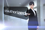 Businesswoman pointing to word unauthorized