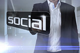 Businessman pointing to word social