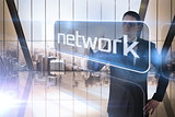 Businessman presenting the word network