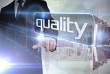 Businessman presenting the word quality