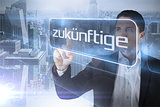 Businessman presenting the word future in german