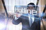 Businessman presenting the word hotline