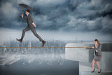 Young businesswoman pulling a tightrope for businessman