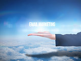 Businesswomans hand presenting email marketing