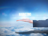 Businesswomans hand presenting the word marketing