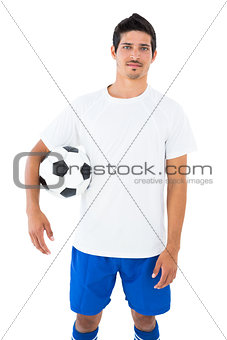 Football player in white holding ball