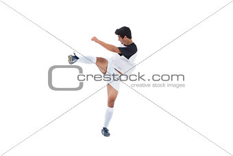 Football player in white kicking