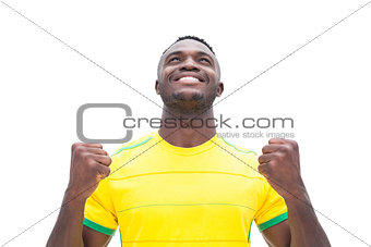 Football player in yellow celebrating a win