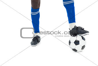 Football player in blue with ball