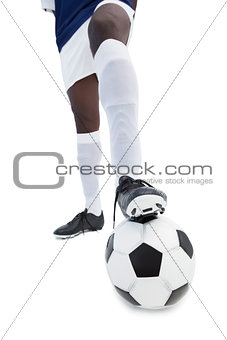 Football player standing with the ball