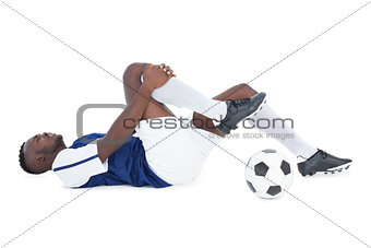 Football player lying down injured