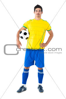 Football player in yellow holding the ball