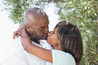 Attractive couple embracing in their garden
