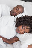 Happy couple lying in bed together sleeping