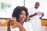 Pretty woman in bathrobe having juice