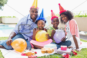 Happy family celebrating a birthday together in the garden