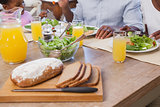 Family having lunch together of bread and salad