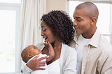 Happy young parents spending time with baby