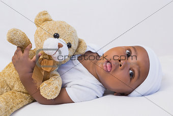 Adorable baby boy with teddy
