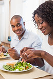 Happy couple enjoying a healthy meal together