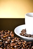 white cup with coffee near coffee beans