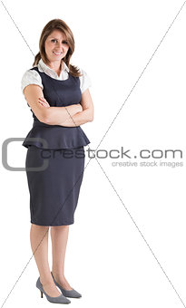 Beautiful young businesswoman with arms crossed