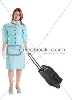 Portrait of stewardess in blue uniform with her bag