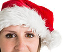 Close up portrait of pretty woman in santa hat smiling