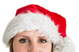 Close up portrait of pretty woman in santa hat