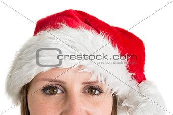 Close up portrait of pretty woman in santa hat