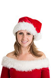 Portrait of pretty young woman in santa costume smiling