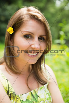 Close up portrait of a cute woman in field