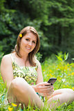 Relaxed woman text messaging in field
