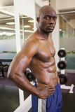 Shirtless muscular man in gym