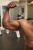Muscular man flexing muscles