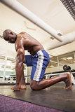 Shirtless muscular man at gym