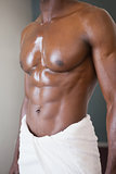 Mid section of a muscular man in white towel