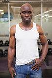 Serious muscular man in gym